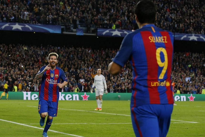 Lionel Messi celebrates with Luis Suarez after scoring his third goal to complete his hat trick against Manchester City.