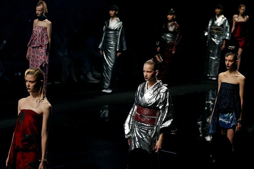 Models present creations by Japanese designer Yoshiki, from his Spring-Summer 2017 collection during Fashion Week Tokyo.