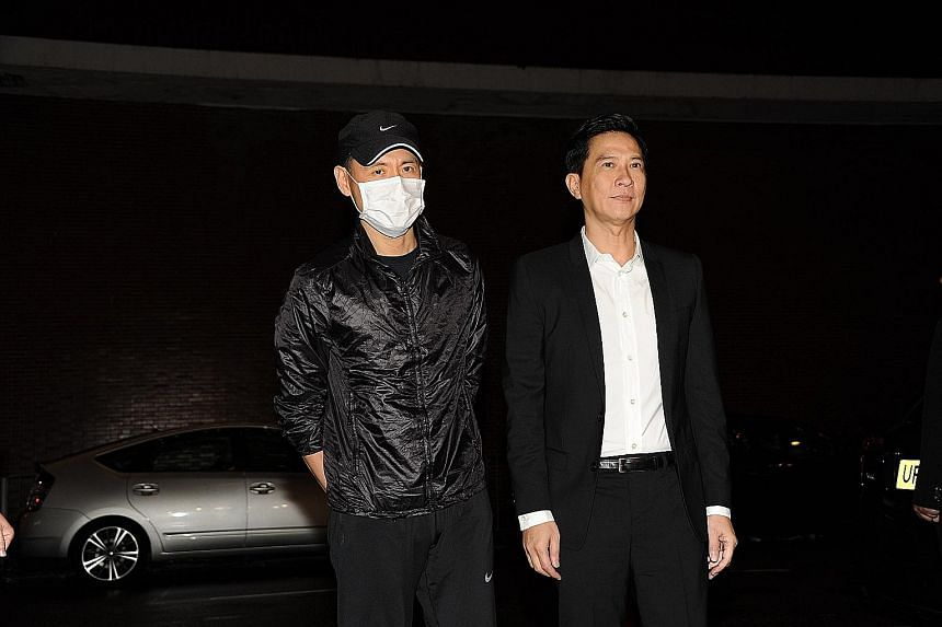 Singer Jacky Cheung (right) and actor Nick Cheung (far right) were among those who attended the wake of the wife of Woo Fung (above).