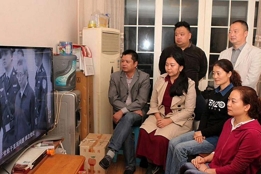 Chinese viewers watching Always On The Road, part of President Xi's immense anti-corruption drive.