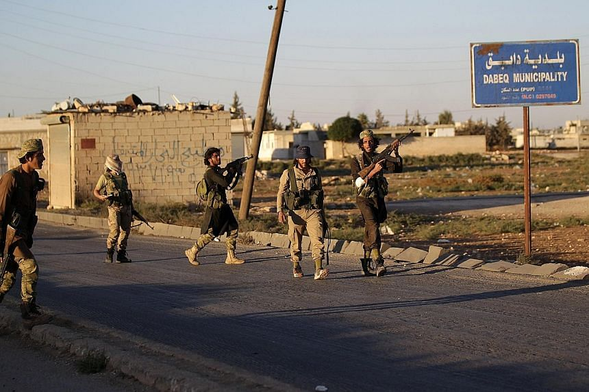 Rebel fighters in the northern Syrian countryside on Sunday. As rebel forces continue to gain ground against ISIS, the group's proclamations have changed tone in preparation for prolonged retrenchment and survival.