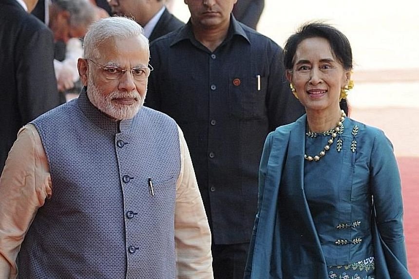 Ms Suu Kyi with Mr Modi during her reception in New Delhi on Tuesday. Ms Suu Kyi is on her first visit to India.