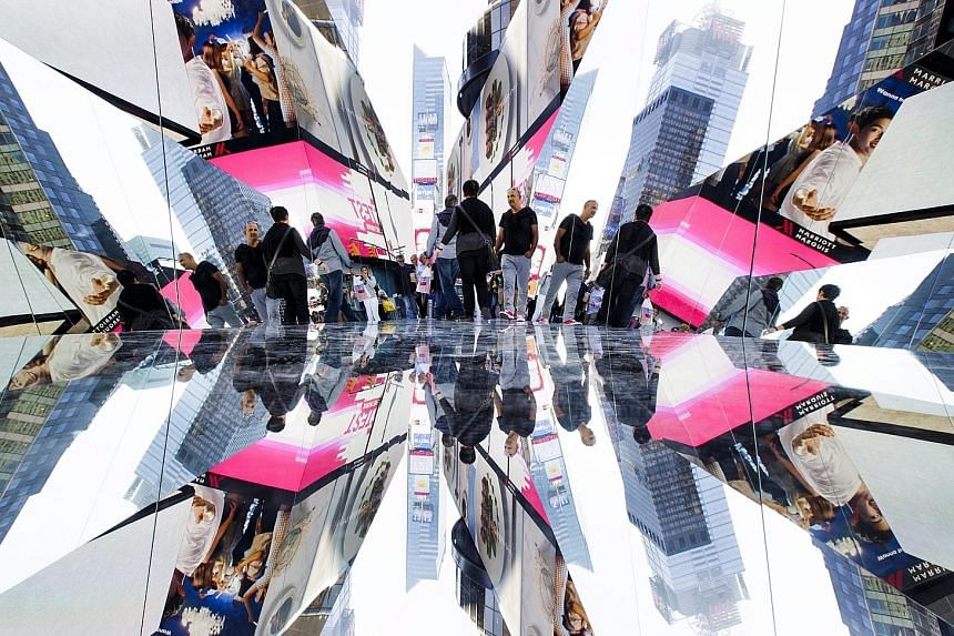 An art installation by Cuban artist Rachel Valdes Camejo titled The Beginning Of The End in Times Square in New York City in the US. The work, which is on display until Nov 21, is an interactive kaleidoscope-like corridor with mirrors on three sides