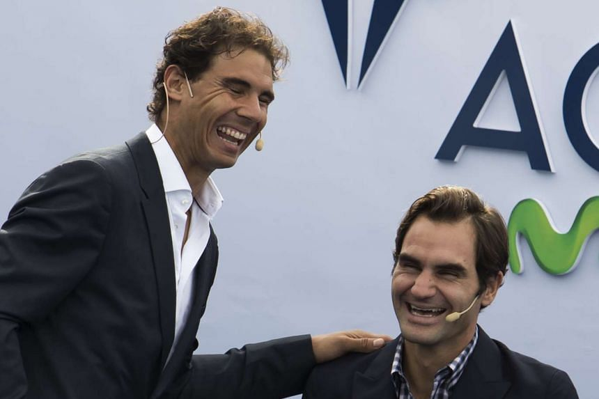 Nadal (left) and Federer smile during the opening of the Rafa Nadal Academy in Manacor on Oct 19, 2016.