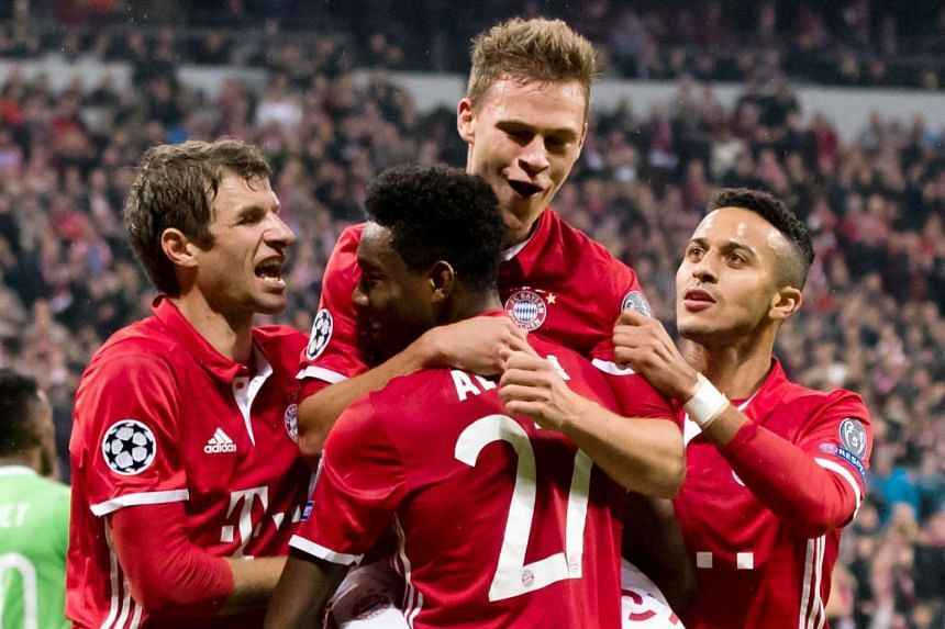 Joshua Kimmich (centre-top) of Bayern celebrates scoring the 2-0 goal with teammates.