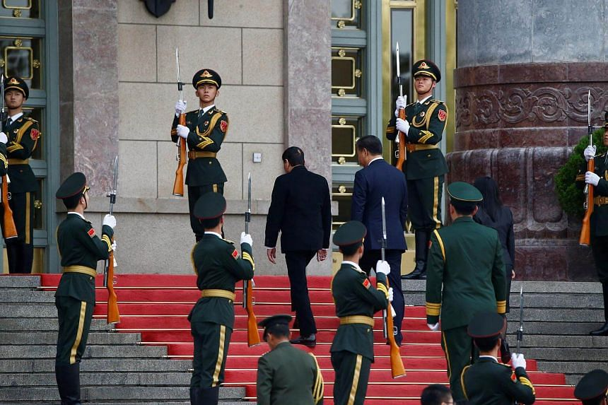 President of the Philippines Rodrigo Duterte and Chinese President Xi Jinping attend a welcoming ceremony at the Great Hall of the People in Beijing, China.