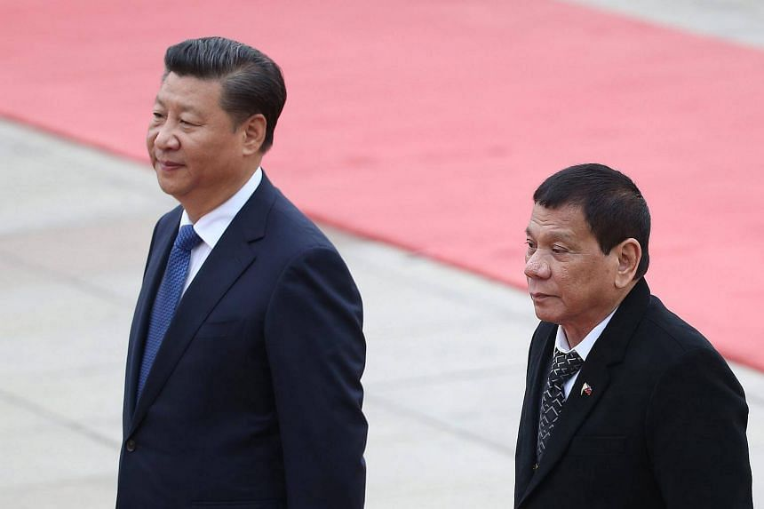 Philippines President Rodrigo Duterte and Chinese President Xi Jinping review honour guards during a welcome ceremony.