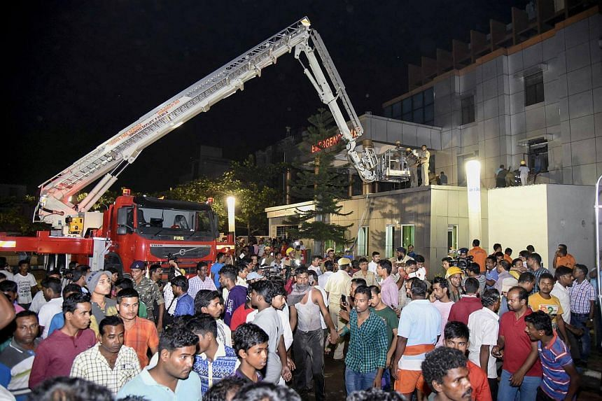 Indian rescue workers trying help victims of a massive fire at the SUM hospital building in Bhubaneswar.