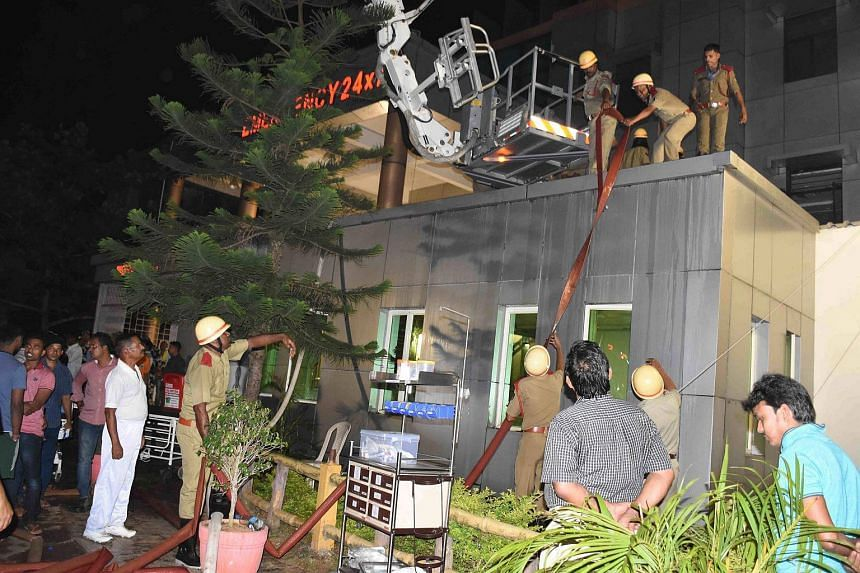 Firefighters trying to douse a fire that broke out in the Intensive Care Unit (ICU) of SUM hospital in Bhubaneswar.