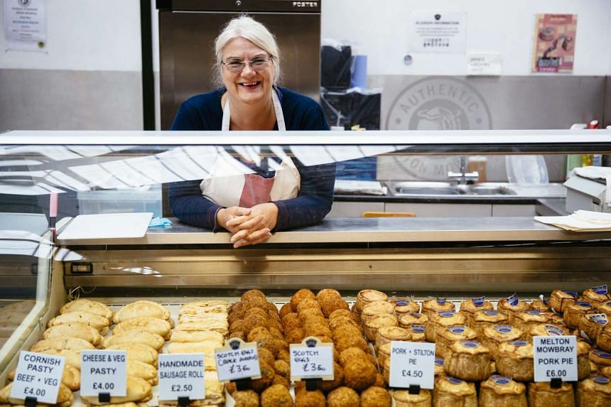Long-time baker Zoe Tew, manager of the Mrs. King's Pork Pies stall at the Borough Market in London, is glad that supermarkets now have bigger baking sections, thanks to the popularity of The Great British Bake Off.