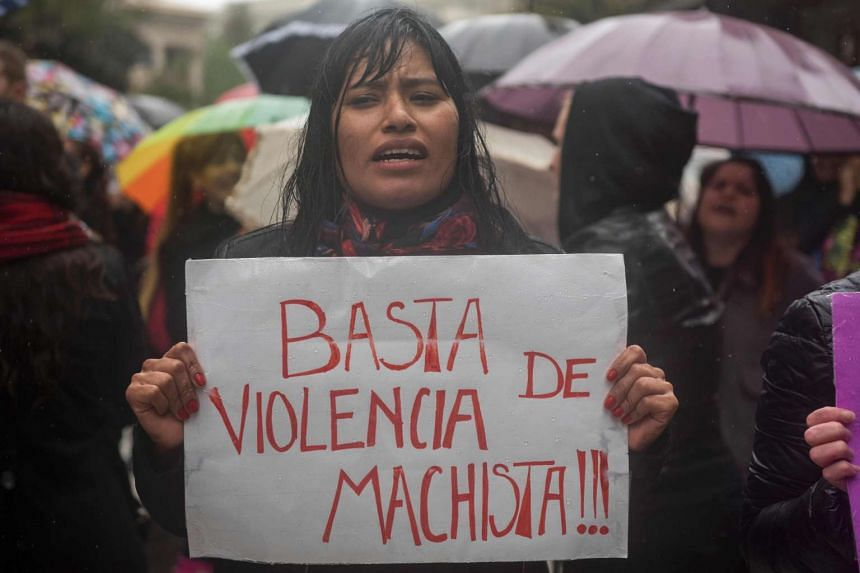 "Women stop work and other activities for an hour to join a ""women's strike"" organised after the brutal killing of a 16-year-old girl, in Buenos Aires, on Oct 19, 2016."