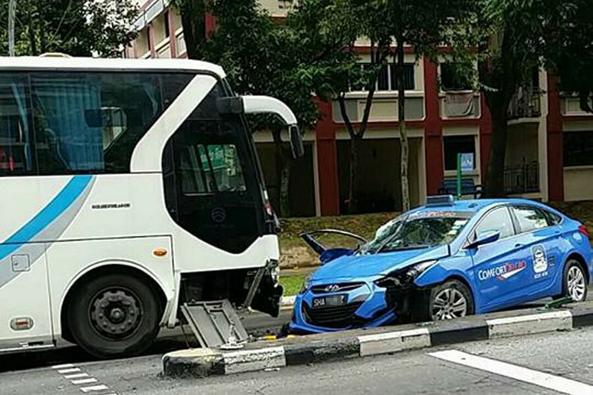 Accident between a taxi and a private bus at Woodlands Avenue 6 on Oct 19, 2016.