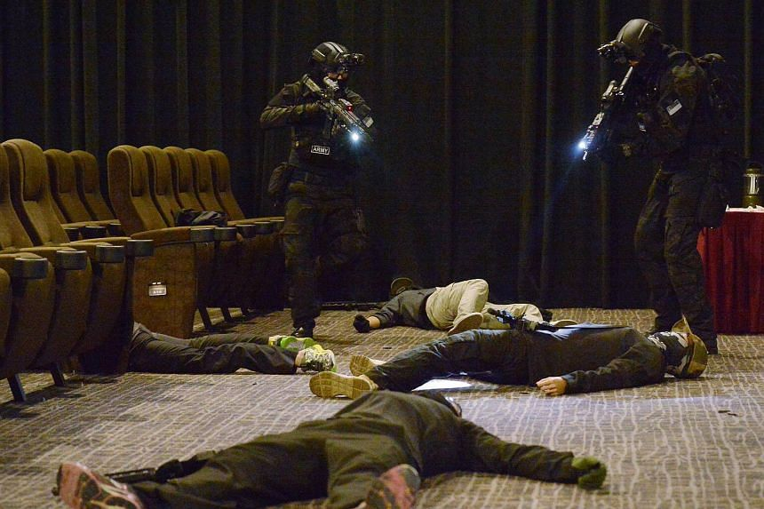 """Special Operations Task Force officers had taken out five """"terrorists"""" storming a cinema during a media preview of the counter- terrorism exercise on Oct 17, 2016."""