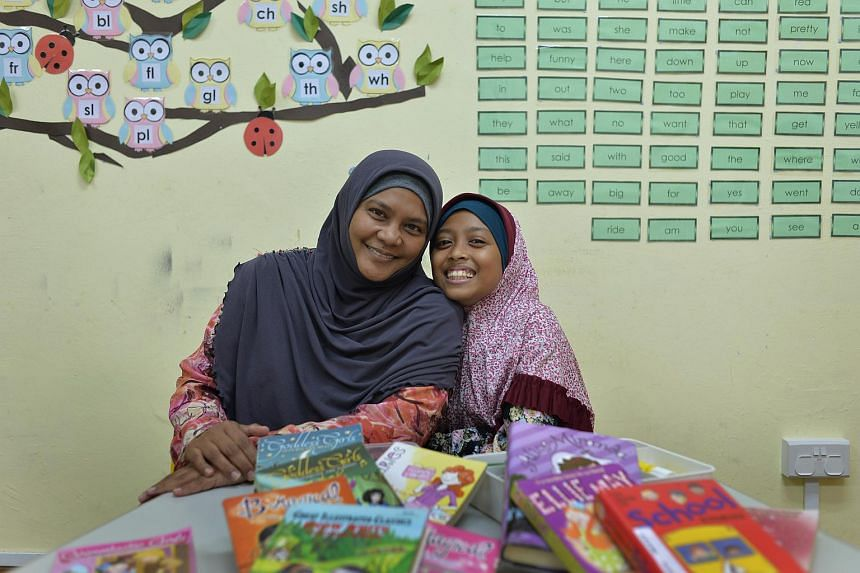Siti Hawa Najib, 12 and her mother Mastzainah Jalil at the Dyslexia Association of Singapore (DAS) Tampines Learning Centre.