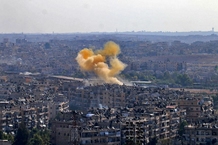 Smoke rises from reported opposition fire from buildings in an eastern government-held neighbourhood of the northern Syrian city of Aleppo on Oct 20, 2016.