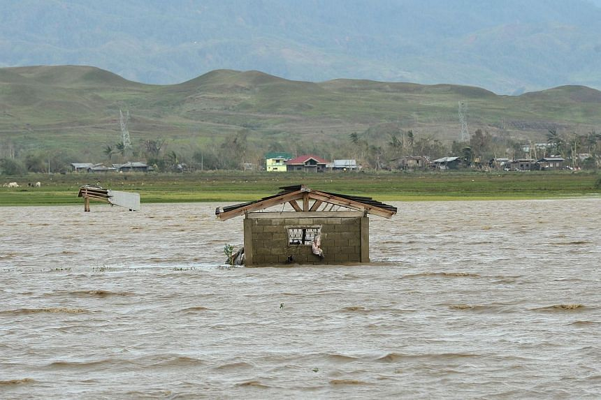 A house stands in a rice field flooded by rain brought by super typhoon Haima in Tumauini town, Isabela province, Philippines on Oct 20, 2016.