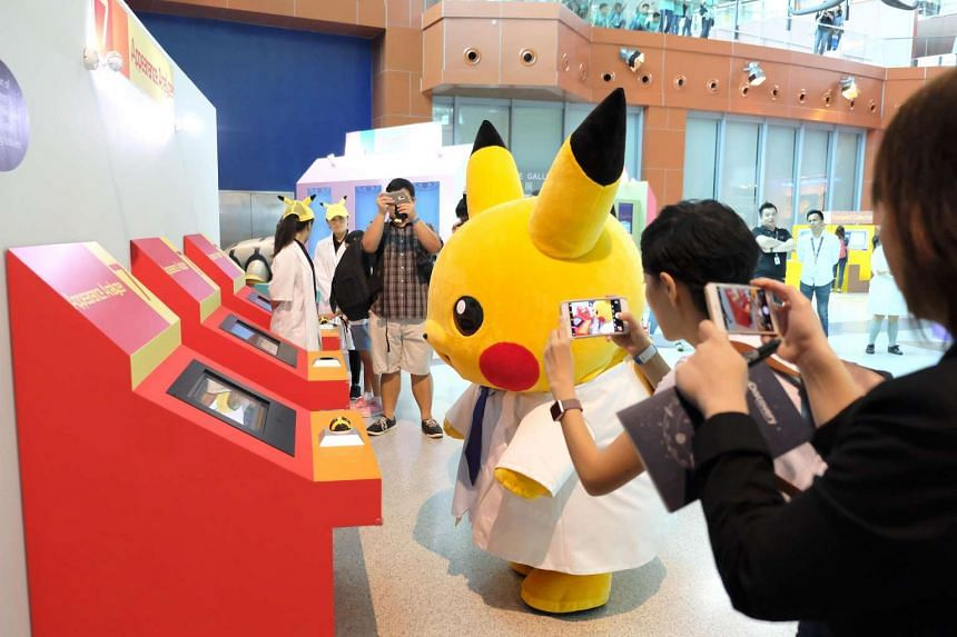 Professor Pikachu also trying its hands on guessing the Pokemon within the Pokeball in the Pokemon Research Exhibition at S.E.A Aquarium in Resorts World Sentosa.