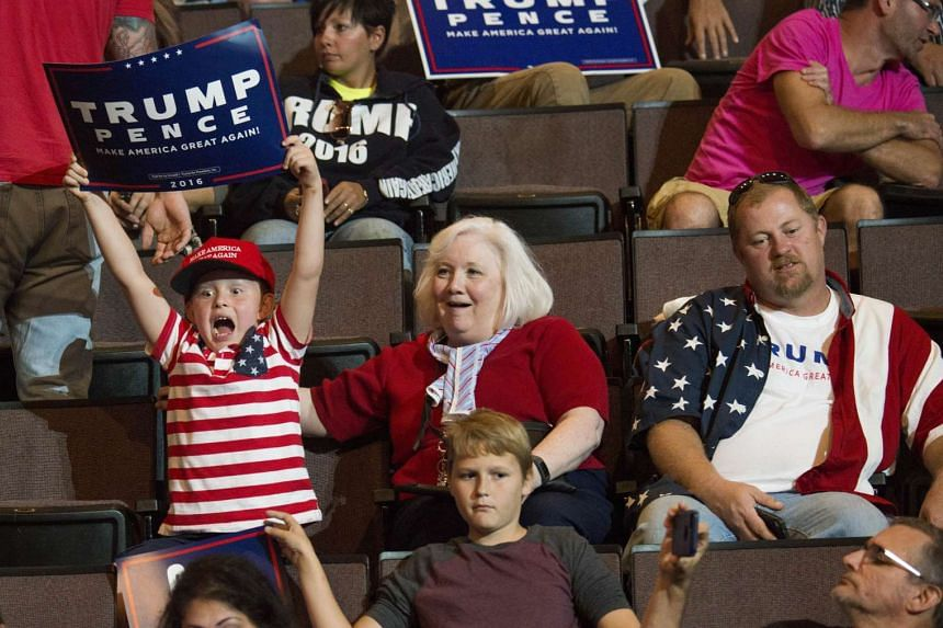 A little boy shows his excitement holding up his campaign sign before Donald Trump speaks at US Bank Arena on Oct 13, 2016 in Cincinnati, Ohio.
