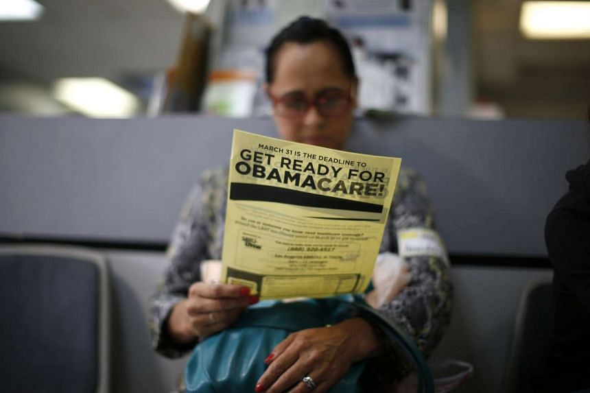 Arminda Murillo, 54, reads a leaflet on Obamacare at a health insurance enrollment event in Cudahy, California, US on March 27, 2014.