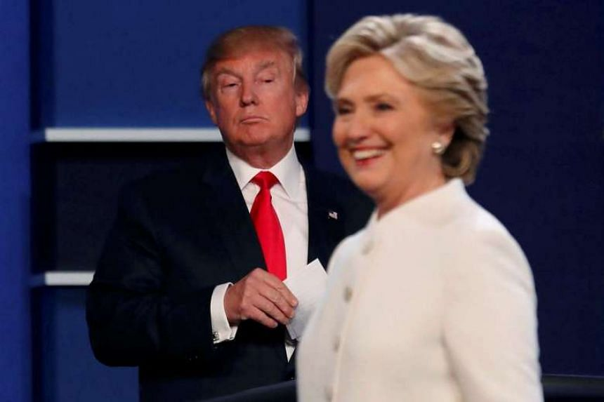 Trump and Clinton finish their third and final presidential campaign debate on Oct 19, 2016.