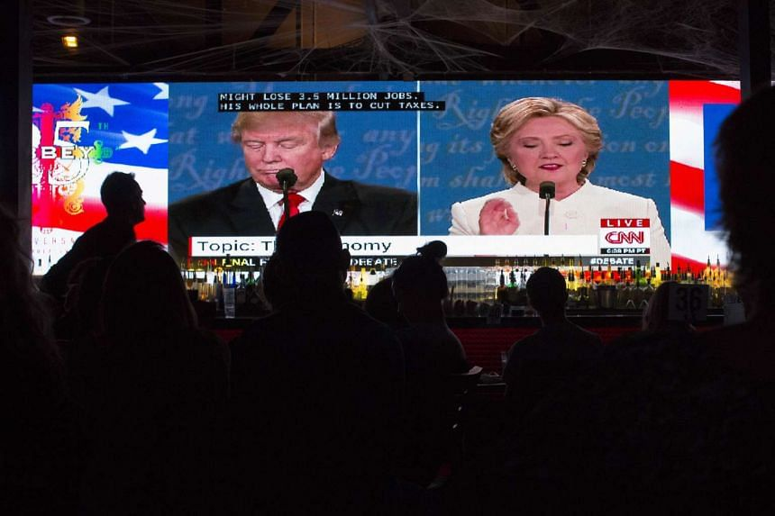 People at The Abbey bar watch the third and final presidential debate between Republican Donald Trump and Democrat Hillary Clinton on Oct 19, 2016 in West Hollywood, California.