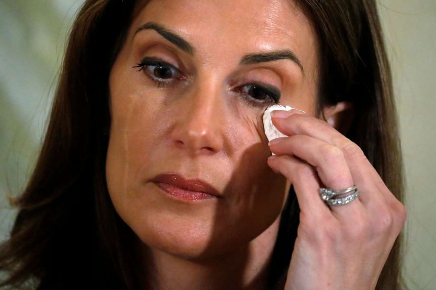 Tears stream down the face of Karena Virginia who claimed to be the victim of sexual assault by Republican presidential candidate Trump back in 1998, during a news conference in the Manhattan borough of New York, New York, US on Oct 20, 2016.
