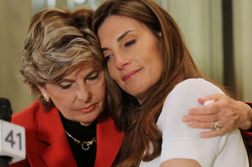 Karena Virginia (right) is comforted by Gloria Alfred during a press conference where Karena Virginia identified herself as victim of sexual misconduct by Republican Presidential Candidate Donald Trump at a press conference at The London Hotel on Oct
