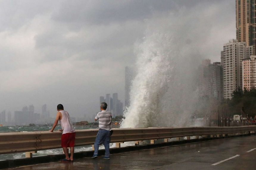 Big waves hit a waterfront as Typhoon Haima approaches in Hong Kong on Oct 21, 2016.