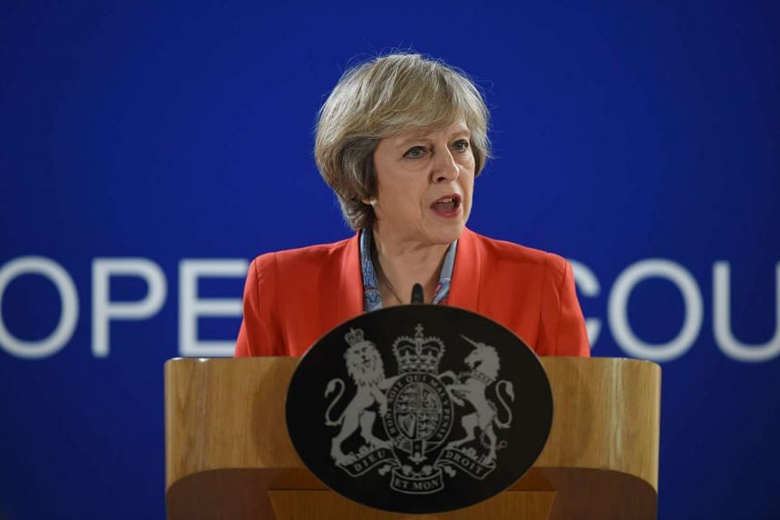 British Prime minister Theresa May delivers a speech during a press conference on the second day of a European Union leaders summit on Oct 21, 2016.
