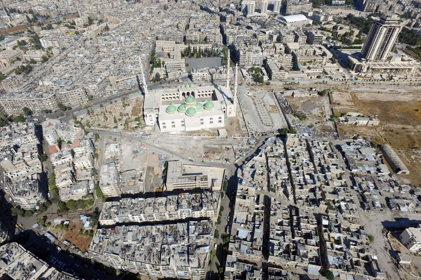 A general view taken with a drone shows a mosque where forces loyal to Syria's President Bashar al-Assad are stationed in Aleppo's government-controlled area of al-Masharqa in Syria on Oct 20, 2016.