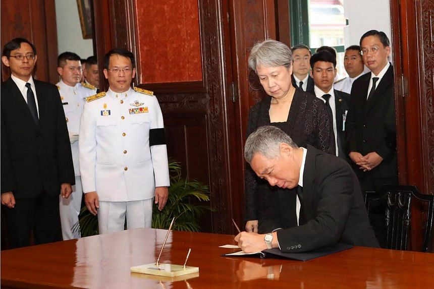 Prime Minister Lee Hsien Loong signing the condolence book for King Bhumibol Adulyadej at the Grand Palace on Oct 21, 2016.