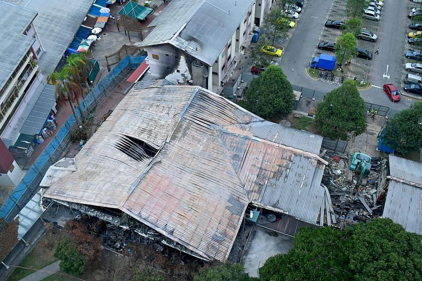 Demolition work was under way yesterday at Block 493, Jurong West Street 41 - housing a wet market and a coffee shop - that was badly damaged in a fire last week. The Housing Board said on Wednesday that the process will take about three weeks to com