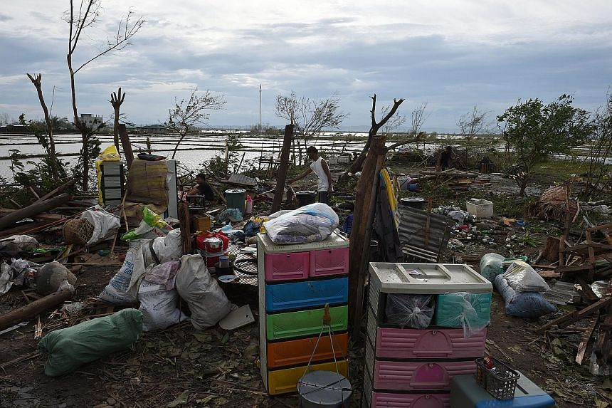A resident surveying the remains of his house in Cabagan town in Isabela province yesterday after it was destroyed by Super Typhoon Haima. The storm made landfall in Isabela late on Wednesday night.