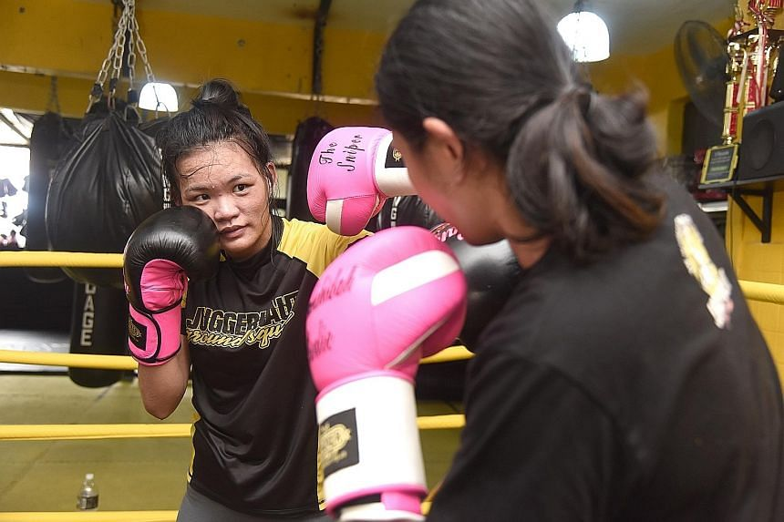 Mixed martial arts fighter Tiffany Teo (left) and Nurshahidah Roslie, Singapore's first female professional boxer, training ahead of their respective fights next month. Teo will take on Walaa Abbas at ONE: Defending Honor while Nurshahidah will face