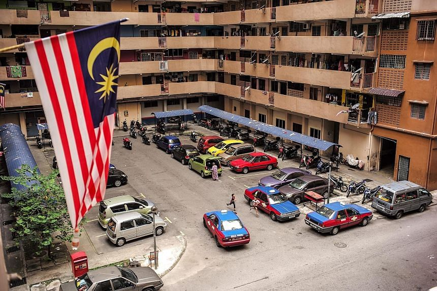 A public housing block in Kuala Lumpur. With high house prices a persistent complaint among Malaysians, Mr Najib is expected to offer further support for low- and mid-range house buyers.