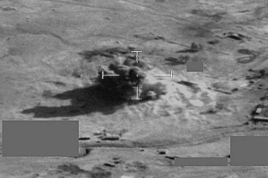 A combination video grab handout showing a British Royal Air Force Typhoon aircraft targeting a vehicle and using a Paveway guided bomb to safely dispose of a large truck-bomb, before it could be used by ISIS. Left: Peshmerga forces firing an anti-ai