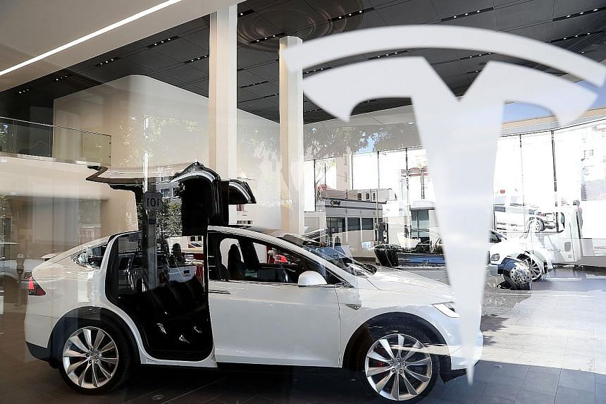 A Model X sport utility vehicle on display at Tesla's flagship facility in San Francisco. The company now appears to be moving beyond systems that assist human drivers, to newer technology that enables fully autonomous driving.