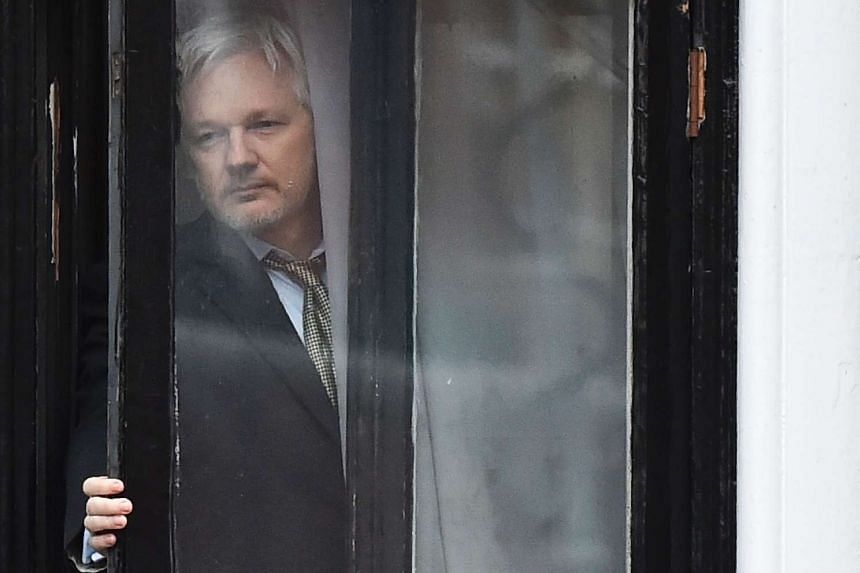 Assange coming out onto the balcony of the Ecuadorian embassy in London to address the media in February 2016.