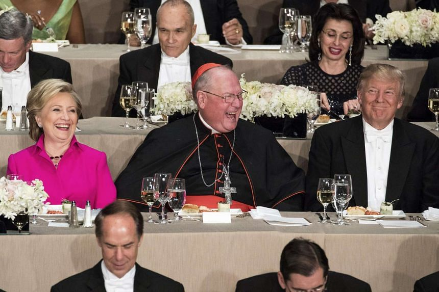Hillary Clinton (left), Donald Trump (right) and Cardinal Timothy Dolan, the archbishop of New York attend the 71st annual Alfred E. Smith Memorial Foundation dinner.