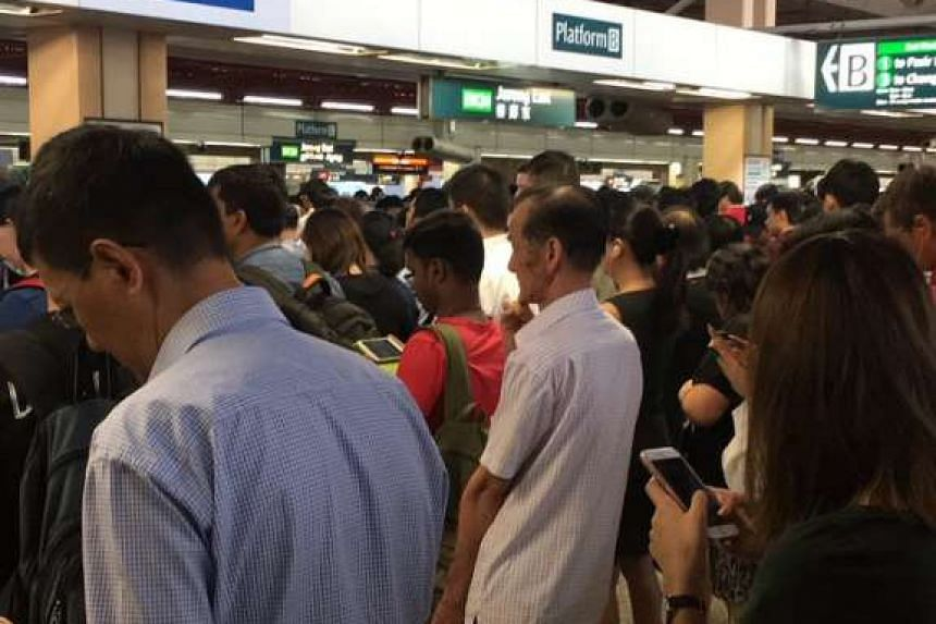 Crowds at Jurong East station after a train fault on the East-West Line caused delays on Friday morning.