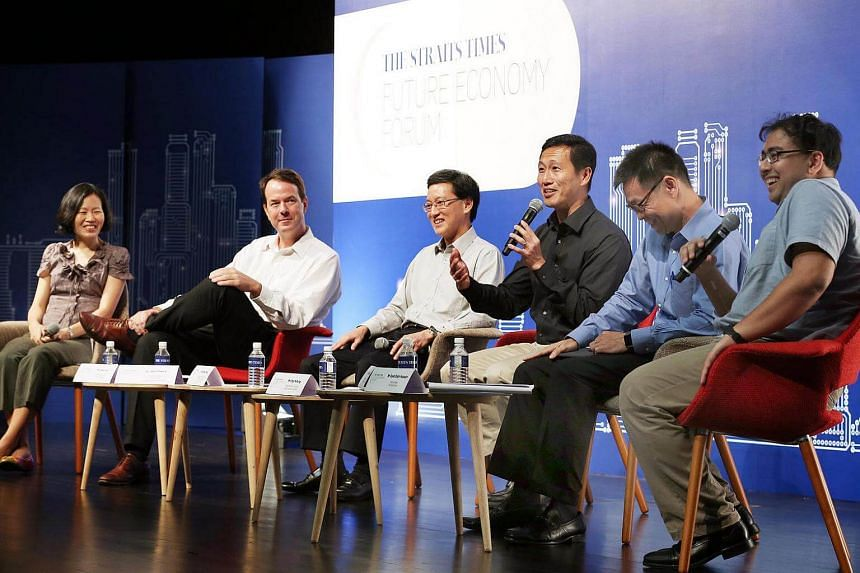 (From left) Ms Lydia Lim, Dr John Powers, Mr Andrew Chong, Minister Ong Ye Kung, Mr Yeoh Keat Chuan and Mr Syed Zakir Hussain at The Straits Times Future Economy Forum.