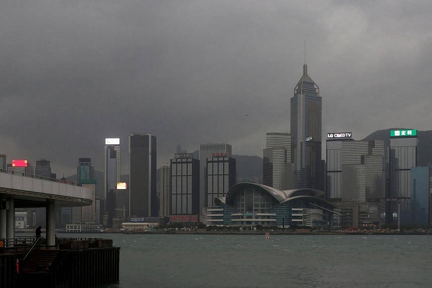A man stands at a pier facing the island skyline as Typhoon Haima approaches in Hong Kong, China on Oct 21, 2016.