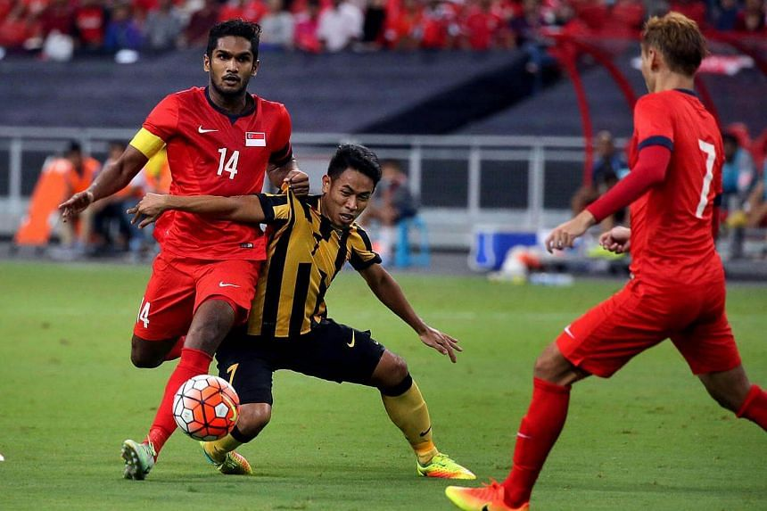 The Lions (in red) in action during the match between Singapore and Malaysia at the Causeway Challenge at National Stadium on Oct 7, 2016.