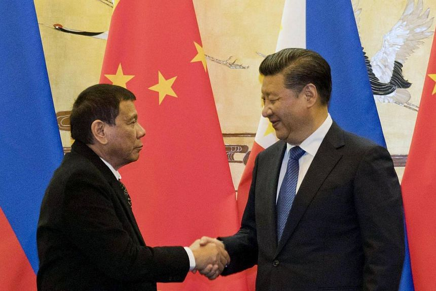 Philippine President Rodrigo Duterte (left) shakes hands with Chinese President Xi Jinping after a signing ceremony in Beijing on Oct 20, 2016.