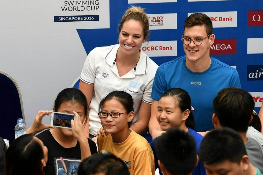 Emily Seebohm and Mitch Larkin posing for a photo with fans during the meet and greet session at Kallang Wave Mall on Oct 20, 2016.