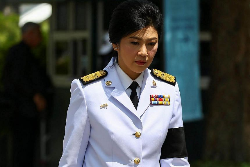 Former Thai Prime Minister Yingluck Shinawatra arrives at the Grand Palace to offer condolences for Thailand's late King Bhumibol Adulyadej, in Bangkok on Oct 14, 2016.