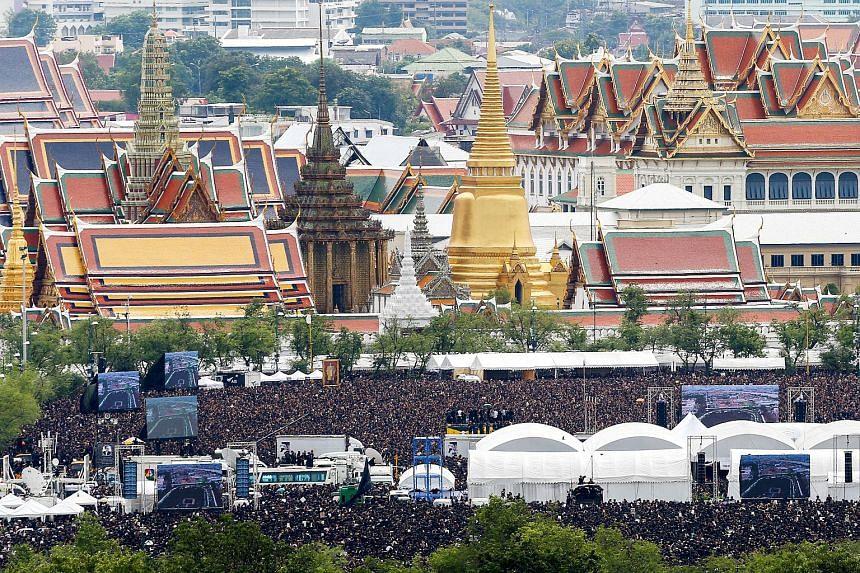 Mourners gather outside of the Grand Palace to sing the royal anthem in honour of Thailand's late King Bhumibol Adulyadej in Bangkok on Oct 22, 2016.