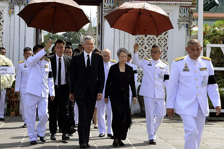 Singaporean Prime Minister Lee Hsien Loong and his wife Ho Ching arriving to mourn for the late Thai King Bhumibol Adulyadej at the Grand Palace in Bangkok on Oct 21, 2016.