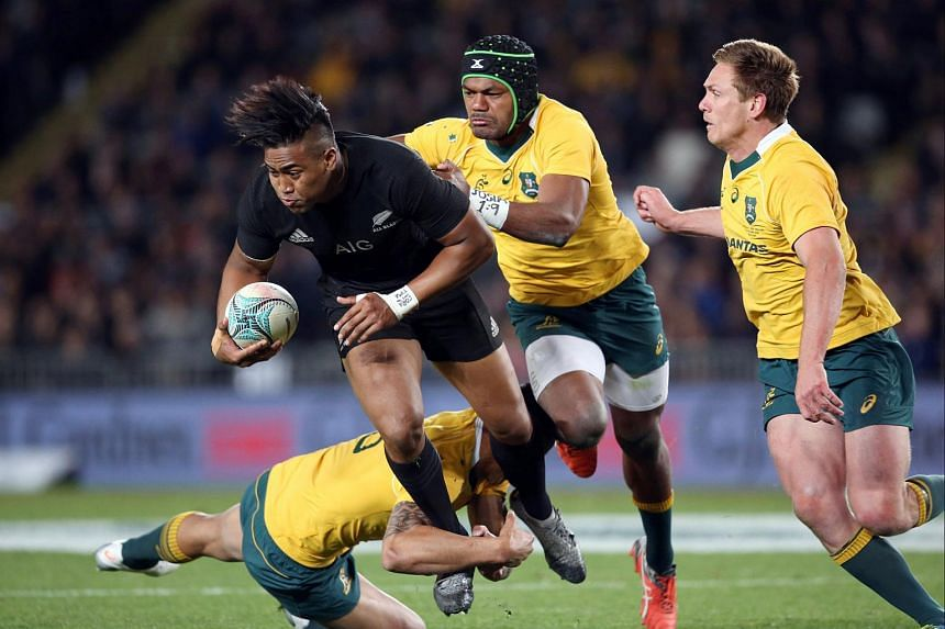 New Zealand's Julian Savea is tackled by Australia's Samu Kerevi (second from right), Bernard Foley (right) and Israel Folau (bottom) during the third rugby Bledisloe Cup Test between the New Zealand All Blacks and Australia at Eden Park in Auckland