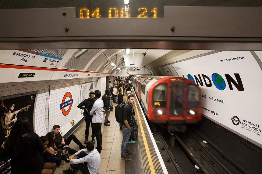 A London Underground train arrives at Oxford Circus station in central London on Aug 20, 2016.